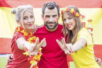 Portrait of Spanish soccer fans with face paint