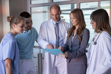 Doctor discussing document with colleagues