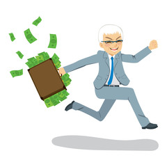 Senior businessman happy running away carrying briefcase full with money spilling