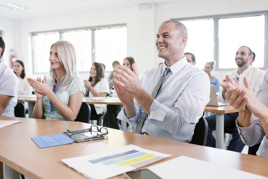 Healthcare workers in training class clapping