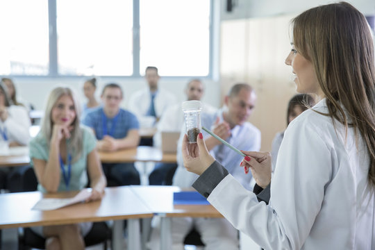 Female doctor explaining medication in training class