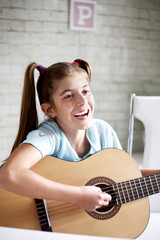 Girl playing guitar at school
