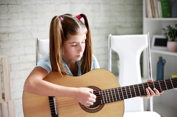 Girl learns to play guitar