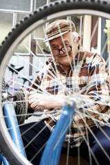 repair of bicycles hobby is an older man
