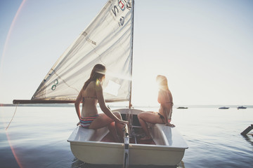 Two young women sailing in dinghy