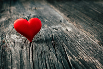 Red heart on wooden background. Valentines day. Copy space
