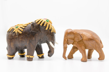 Wood carving elephants in a white background.