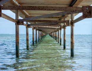 under old rusty pier