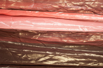 Pink brown transparent fabric. texture. robe.