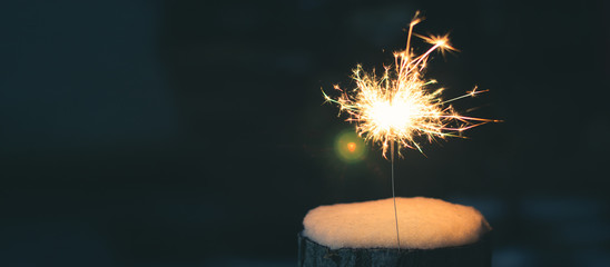 Sparkler in the snow in the evening