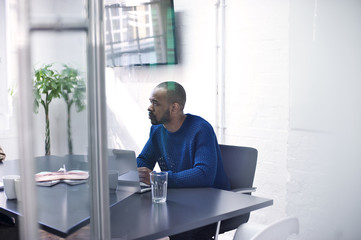 Mixed race creative professional in a meeting in an informal workspace