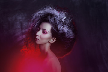 Young attractive brunette girl with great fleece. Dark Gothic image, creative style