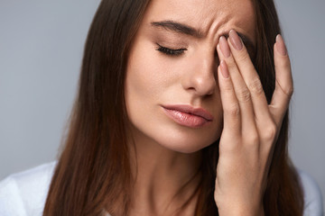 Woman Suffering From Strong Pain, Having Headache, Touching Face