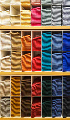 Stack of Clothes on a Shelf