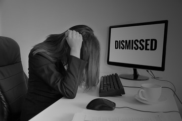 Stressed or headache business woman at office desk, dismissed