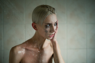 Deeply upset woman with short hair and smeared mascara