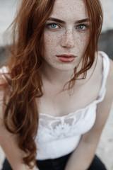 Beautiful redhead girl with blue eyes