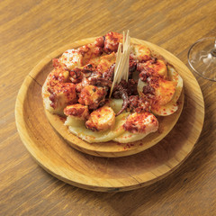Photo of octopus with fried potatoes, typical Spanish dish