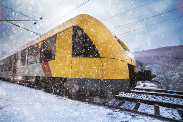 yellow train in the snow