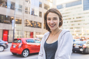 Smiling young woman in the city