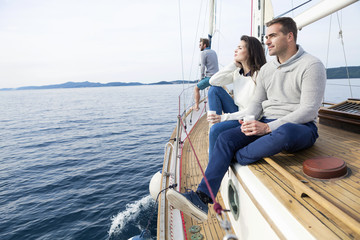 Young couple on yacht looking at sea