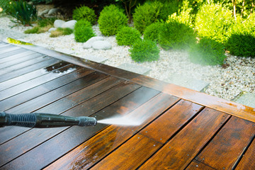 cleaning terrace with a power washer - high water pressure cleaner on wooden terrace surface Wall mural