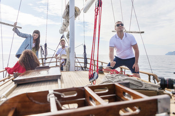 Group of friends on a sailing boat