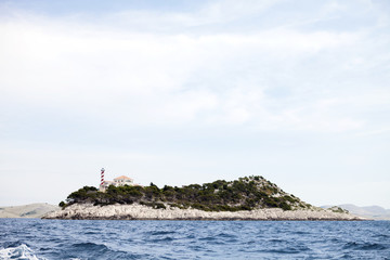 Lighthouse on island in Adriatic Sea