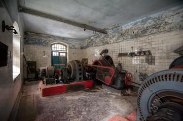 Old abandoned hydro power plant machine hall interior