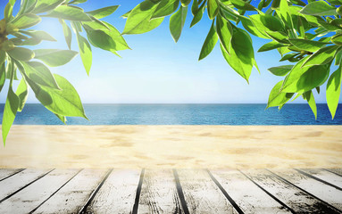 Summer beach wih tree leaves and walking path