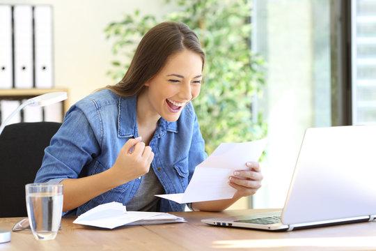 Excited entrepreneur girl reading a letter