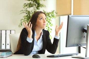 Worried businesswoman praying at office
