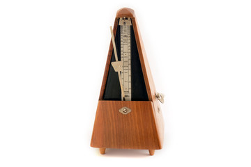 Classic vintage wooden metronome in motion