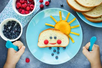 Creative breakfast idea for kids - bread bun with fruit