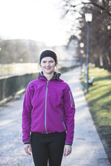 Woman in pink sports clothes and headband