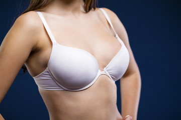 Woman breast in white uplift