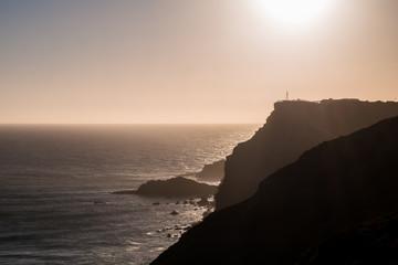 Portugal - Sun setting behind cliffs