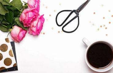 Pink roses, coffee and other things on white background