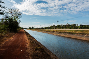 view of canal and road at countryside,Thailand.