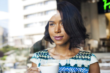 Mixed race woman takes a coffee break