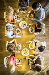 Group of friends on dinner party in restaurant