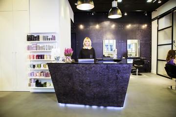 Female receptionist in hair salon