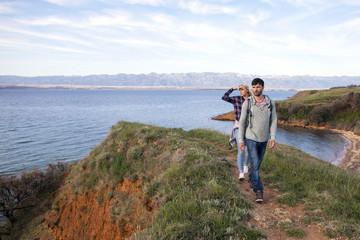 Young couple hiking along coastal path
