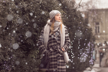 snowing young woman outdoors winter