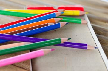 Closeup to man's hands using a Crayon