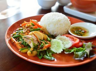 spicy food fried pork with basil leaf
