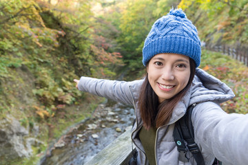 Woman taking selfie at forest landscape