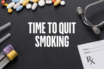 TIME TO QUIT SMOKING written on black background with medication