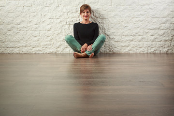 Senior Woman Sitting on Floor