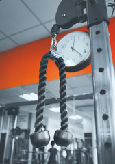 Closeup picture of hanging handle machine in a gym for pulling training